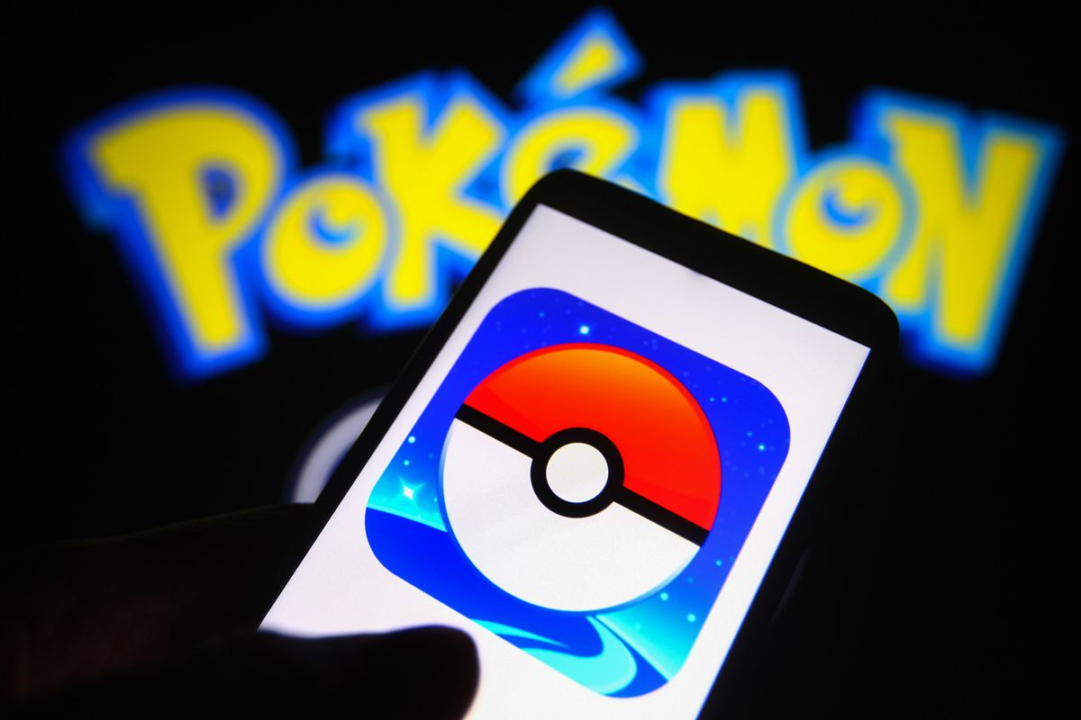 In this photo illustration a Pokémon Go logo is seen on a...