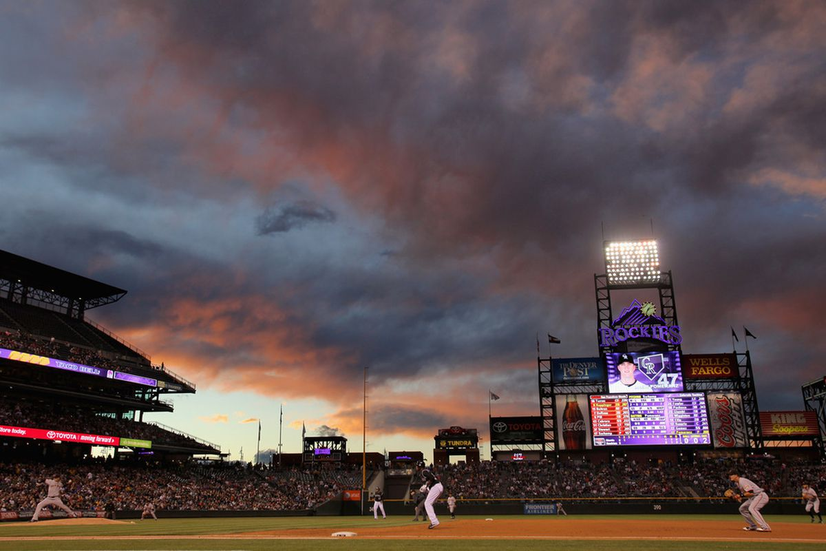 DENVER, CO - SEPTEMBER 17:  The sun sets over the stadium as the San Francisco Giants face the Colorado Rockies at Coors Field on September 17, 2011 in Denver, Colorado.  (Photo by Doug Pensinger/Getty Images)