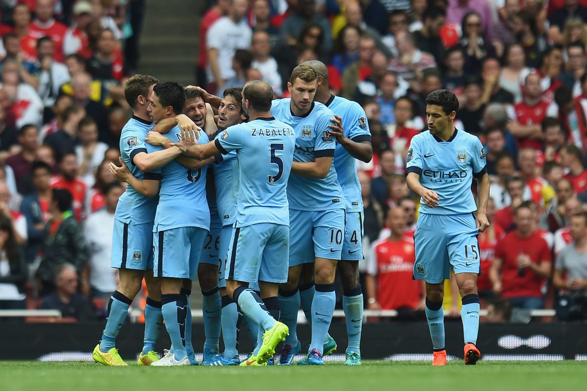 City celebrate their late equalizer at the Emirates