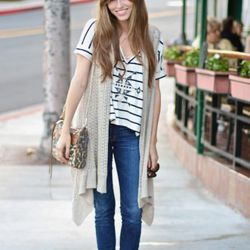 """<a href=""""http://la.racked.com/archives/2011/07/08/lindsey_on_sunset_and_alta_loma.php"""" rel=""""nofollow"""">Lindsey</a>'s top is by Brandy Melville, her sunglasses are Chanel, the bag is Rebecca Minkoff, her jeans are by Elizabeth and James, the vest is from Al"""