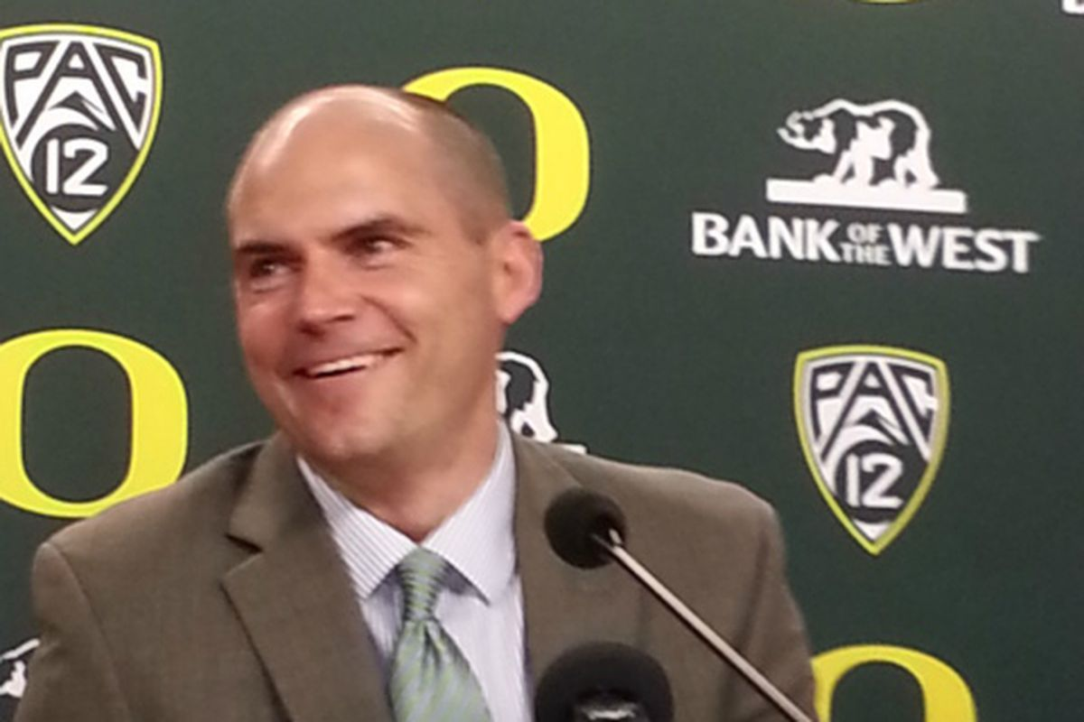 Head coach Mark Helfrich smiles during today's press conference