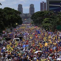 Supporters of opposition presidential candidate Henrique Capriles gather during a campaign rally in Caracas, Venezuela, Sunday, Sept. 30, 2012. Presidential elections in Venezuela are scheduled for Oct. 7.
