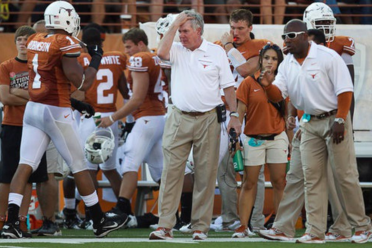 Mack Brown goes facepalm late in the third quarter as OSU's talented running back Jeremy Smith scampers 74 yards for a touchdown all but putting the game out of reach. (Jay Janner AMERICAN-STATESMAN - October 15, 2011)