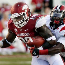 Arkansas tight end Chris Gragg (80) is tackled by Jacksonville State cornerback Brandon Bender (23) during the first quarter of an NCAA college football game in Fayetteville, Ark., Saturday, Sept. 1, 2012.