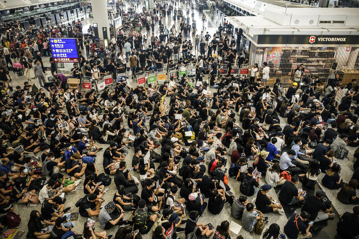 People sit in protest in the Hong Kong airport.