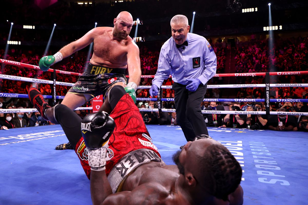 Deontay Wilder is knocked down by Tyson Fury in the third round of their WBC Heavyweight Championship title fight at T-Mobile Arena on October 09, 2021 in Las Vegas, Nevada.