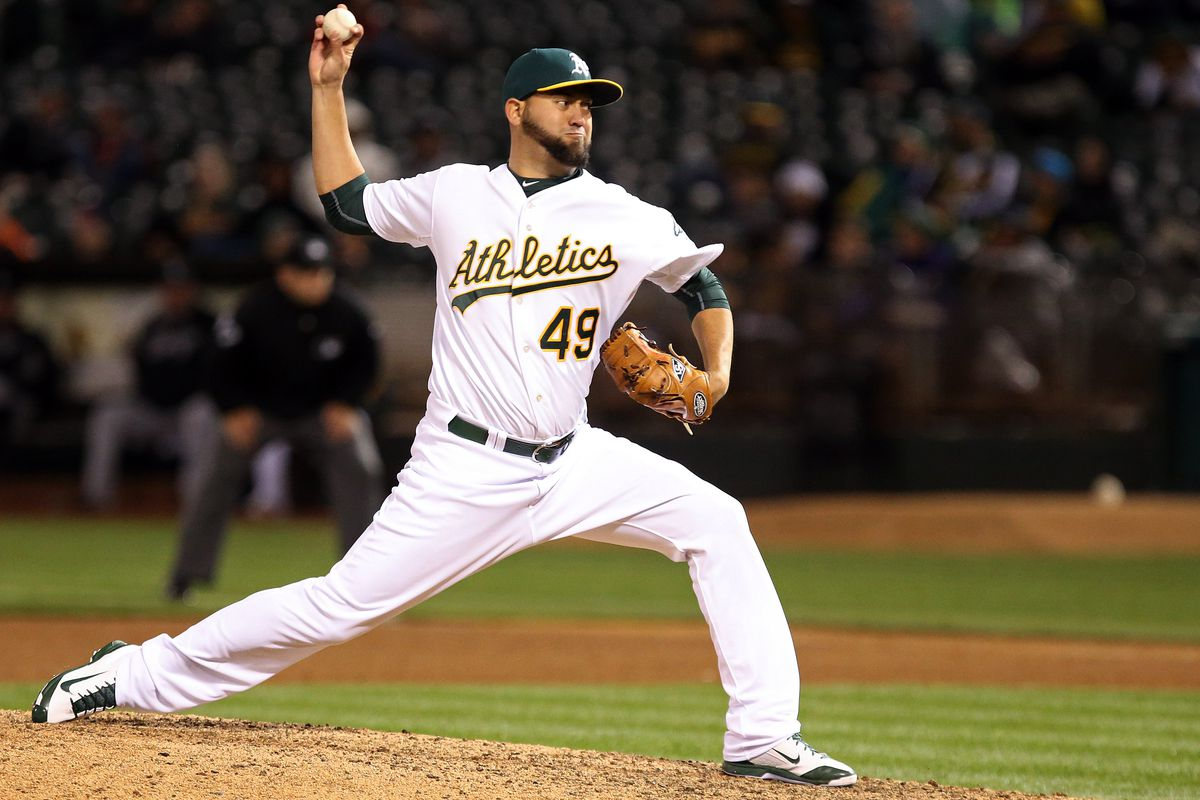 Edward Mujica (49) pitches against the Chicago White Sox during the ninth inning at O.co Coliseum.