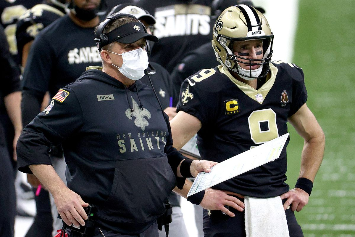 Head coach Sean Payton of the New Orleans Saints and Drew Brees of the New Orleans Saints look on from the sideline against the Chicago Bears during the fourth quarter in the NFC Wild Card Playoff game at Mercedes Benz Superdome on January 10, 2021 in New Orleans, Louisiana.
