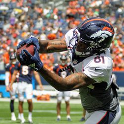 Tim Patrick reaches out and snags a pass at Broncos Training Camp.