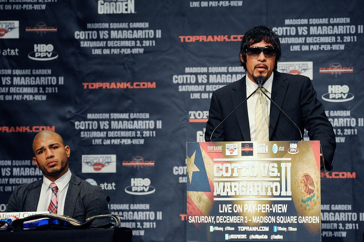 NEW YORK, NY - SEPTEMBER 20:  Professional boxer Miguel Cotto (L) looks on as Antonio Margarito speaks during a press conference at the Edison Ballroom on September 20, 2011 in New York City.  (Photo by Patrick McDermott/Getty Images)