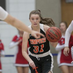 Timpview's Taylor Ross takes the ball down the court during East's 68-48 victory against Timpview in the Class 5A state championship game at Salt Lake Community College in Taylorsville on Saturday, Feb. 24, 2018.