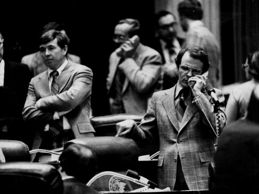 State Rep. Michael Madigan talks on the phone on the House floor in 1979. File Photo.