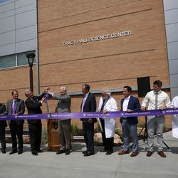 Dignitaries participate in a ribbon-cutting ceremony for the new Tracy Hall Science Center at Weber State University in Ogden on Wednesday, Aug. 24, 2016.