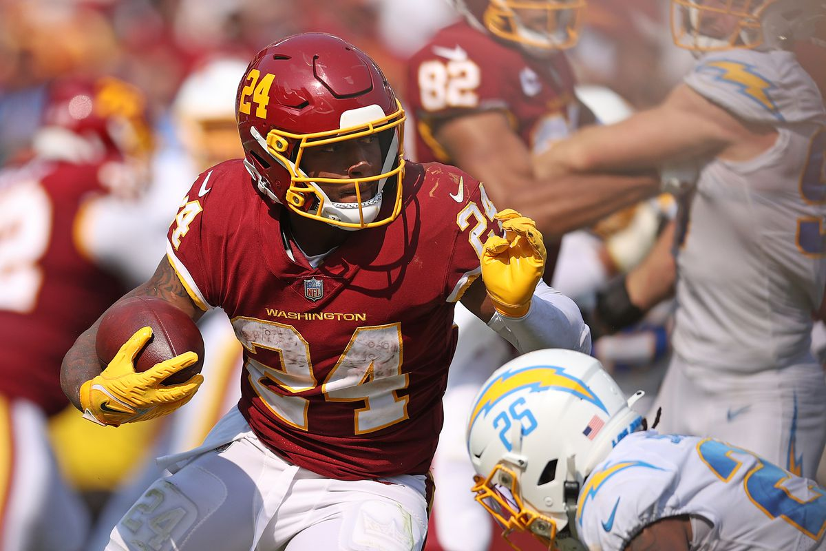 Antonio Gibson #24 of the Washington Football Team runs with the ball during the fourth quarter against the Los Angeles Chargers at FedExField on September 12, 2021 in Landover, Maryland.