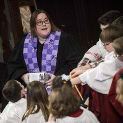 Associate Pastor Rev. Niki Atkinson sits and speaks with children and teen parishioners during Palm Sunday service at First Presbyterian Church in Greensburg, Pa., on Sunday, April 9, 2017.