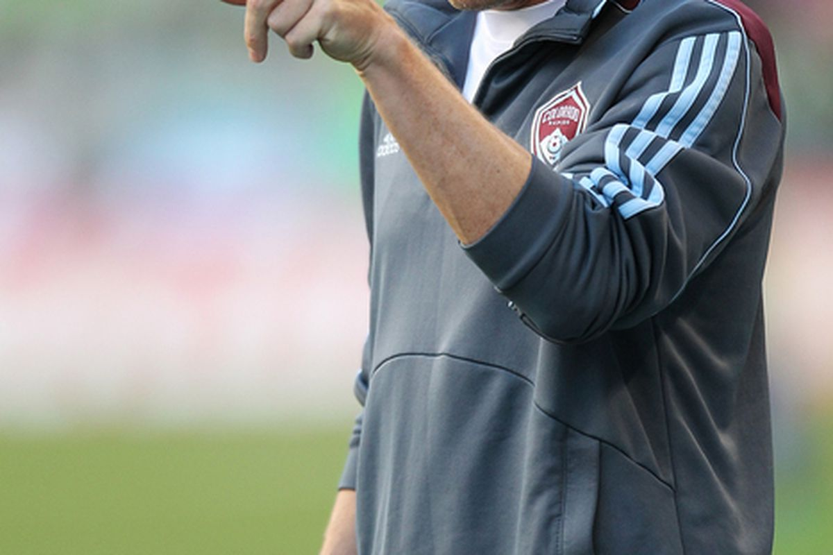 SEATTLE - JULY 25:  Head coach Gary Smith of the Colorado Rapids gestures during the game against the Seattle Sounders FC on July 25 2010 at Qwest Field in Seattle Washington. (Photo by Otto Greule Jr/Getty Images)