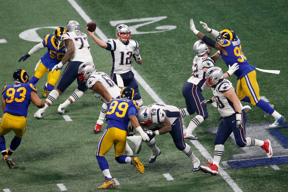 Tom Brady #12 of the New England Patriots passes against the Los Angeles Rams during Super Bowl LIII at Mercedes-Benz Stadium on February 03, 2019 in Atlanta, Georgia.
