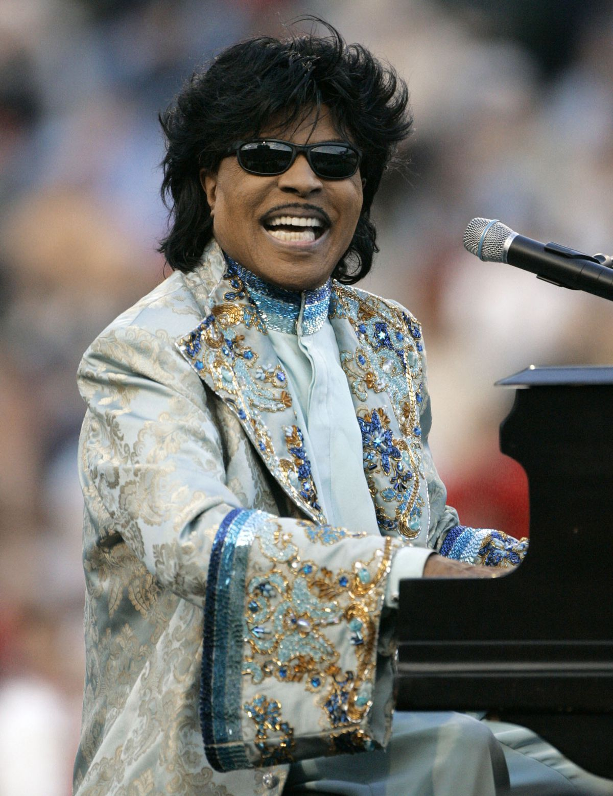 **RESENDING TO CORRECT TRANS REF. NUMBER** **FILE** Little Richard performs during halftime at the Liberty Bowl in this Friday, Dec. 31, 2004 file photo in Memphis, Tenn. Concertgoers won't have to pay for a Little Richard concert in the singer's hometown on Saturday of Macon, Ga. . (AP Photo/Mark Humphrey, FILE) ORG XMIT: NY110