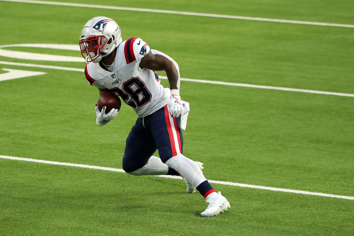 James White #28 of the New England Patriots runs the ball during the first half against the Los Angeles Chargers at SoFi Stadium on December 06, 2020 in Inglewood, California.