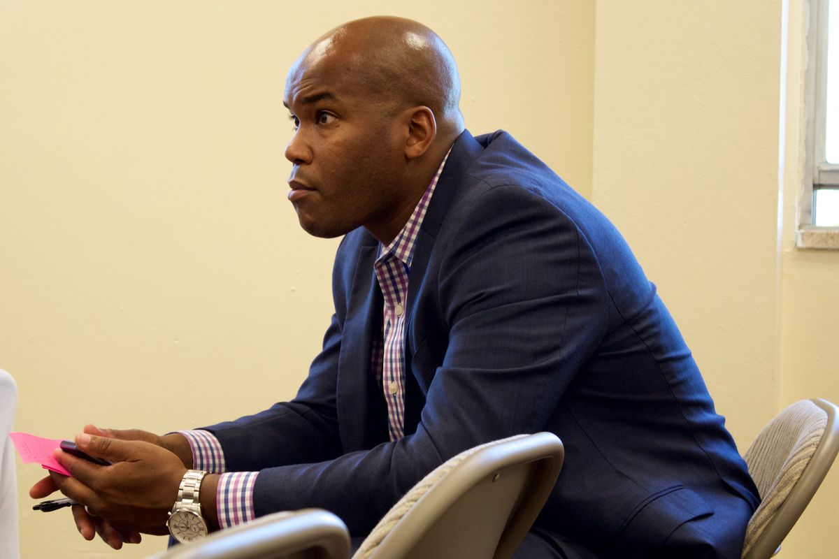 Lamont Browne listens to immigrant parents share their stories about Aurora Public Schools at a forum in June hosted by Rise Colorado.