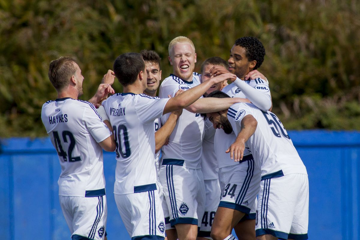 Caleb Clarke (#34) and his teammates celebrate Clarke's 33rd minute goal against TFC2 this afternoon.