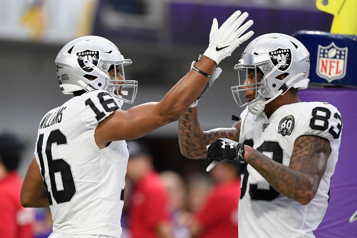 Oakland Raiders tight end Darren Waller congratulates teammate Tyrell Williams #16 on Williams' touchdown against the Minnesota Vikings in the fourth quarter of the game at U.S. Bank Stadium on September 22, 2019 in Minneapolis, Minnesota.