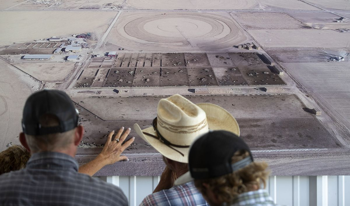 Visitors look at an aerial photograph of the Axtell contract off-range corrals during a tour in Axtell, Sanpete County, on Thursday, Sept. 5, 2019. The Axtell facility is one of two locations in Utah that provides care to wild horses removed from the range.