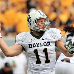 Baylor quarterback Nick Florence (11) throws during their NCAA college football game against West Virginia in Morgantown, W.Va., Saturday, Sept. 29, 2012.