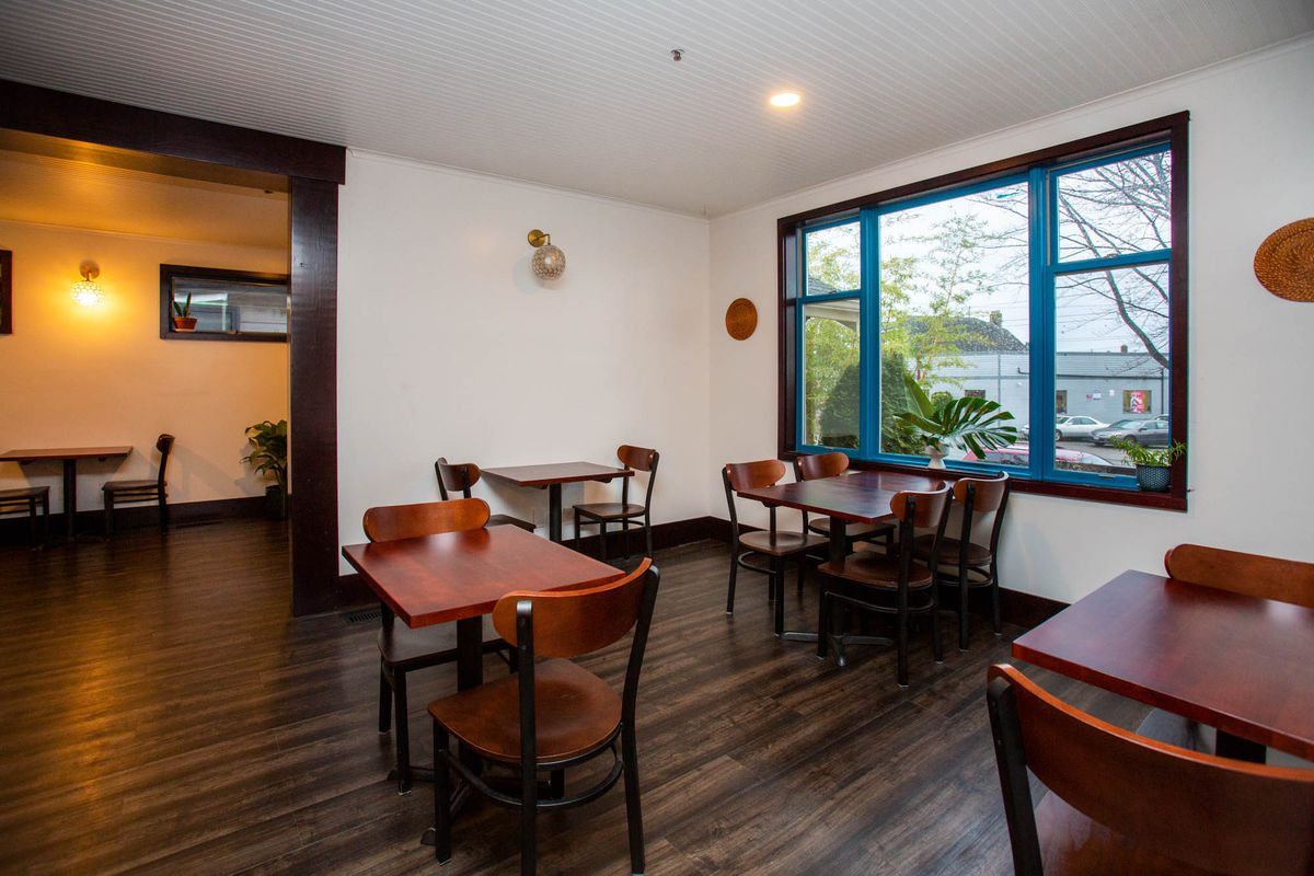 The dining room at Musang, with a view of Beacon Avenue.