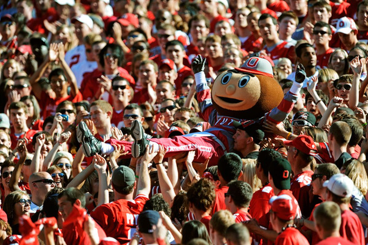 COLUMBUS OH - SEPTEMBER 25:  Mascot Brutus Buckeye is carried up the stands by fans during a game against the Eastern Michigan Eagles at Ohio Stadium on September 25 2010 in Columbus Ohio.  (Photo by Jamie Sabau/Getty Images)