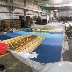 The entire tifo laid out in the Neshaminy creek Brewing Company warehouse where it was painted.