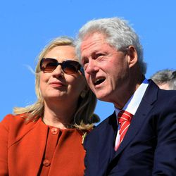 Former President Bill Clinton talks with his wife, U.S. Secretary of State Hillary Rodham Clinton, during a dedication ceremony for the Clinton Presidential Park Bridge, Friday, Sept. 30, 2011, in Little Rock, Ark.