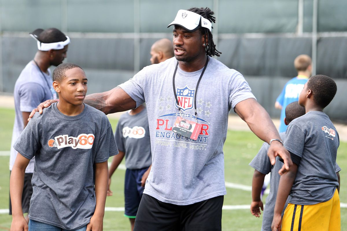 Oakland Raiders linebacker Sio Moore engaging in NFL Play 60 at the 2013 Rookie Symposium