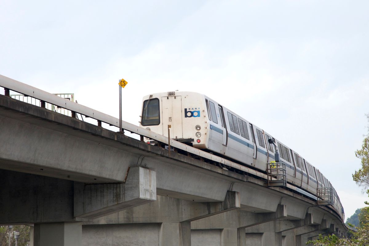 A BART train running on an elevated track.