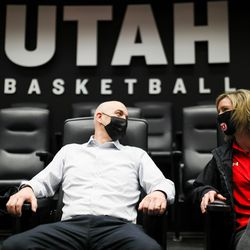 New Utah men's basketball coach Craig Smith takes a load off with wife Darcy while touring the Utes' practice facilities on on March 27, 2021.