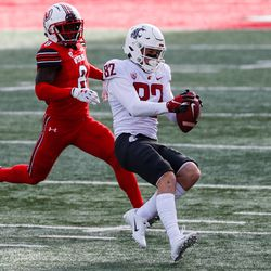 Washington State Cougars wide receiver Lucas Bacon (82) makes a catch against Utah Utes cornerback Clark Phillips III (8) during an NCAA football game at Rice-Eccles Stadium in Salt Lake City on Saturday, Dec. 19, 2020.