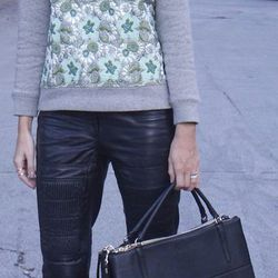 McFadden with the so-hot-right-now bag (and chic leather pants.)