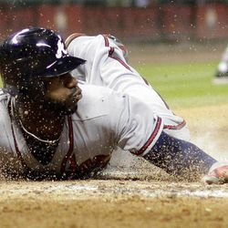 Atlanta Braves' Jason Heyward slides across home plate to score during the fourth inning of a baseball game against the Houston Astros, Wednesday, April 11, 2012, in Houston.