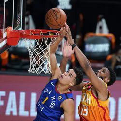 Denver Nuggets' Michael Porter Jr. (1) and Utah Jazz's Tony Bradley (13) reach for the ball during the first half of an NBA basketball first round playoff game Sunday, Aug. 23, 2020, in Lake Buena Vista, Fla.