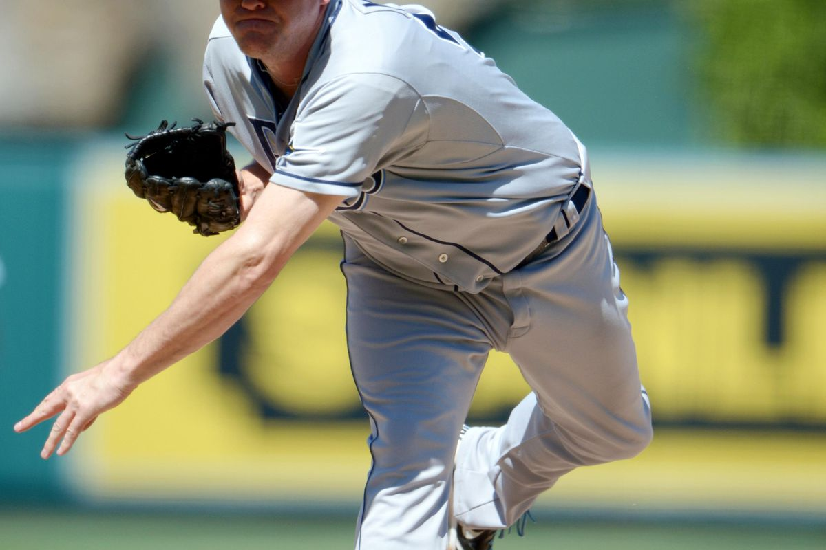 Aug 19, 2012; Anaheim, CA, USA; Tampa Bay Rays reliever Jake McGee (57) delivers a pitch against the Los Angeles Angels at Angel Stadium. The Rays defeated the Angels 8-2. Mandatory Credit: Kirby Lee/Image of Sport-US PRESSWIRE
