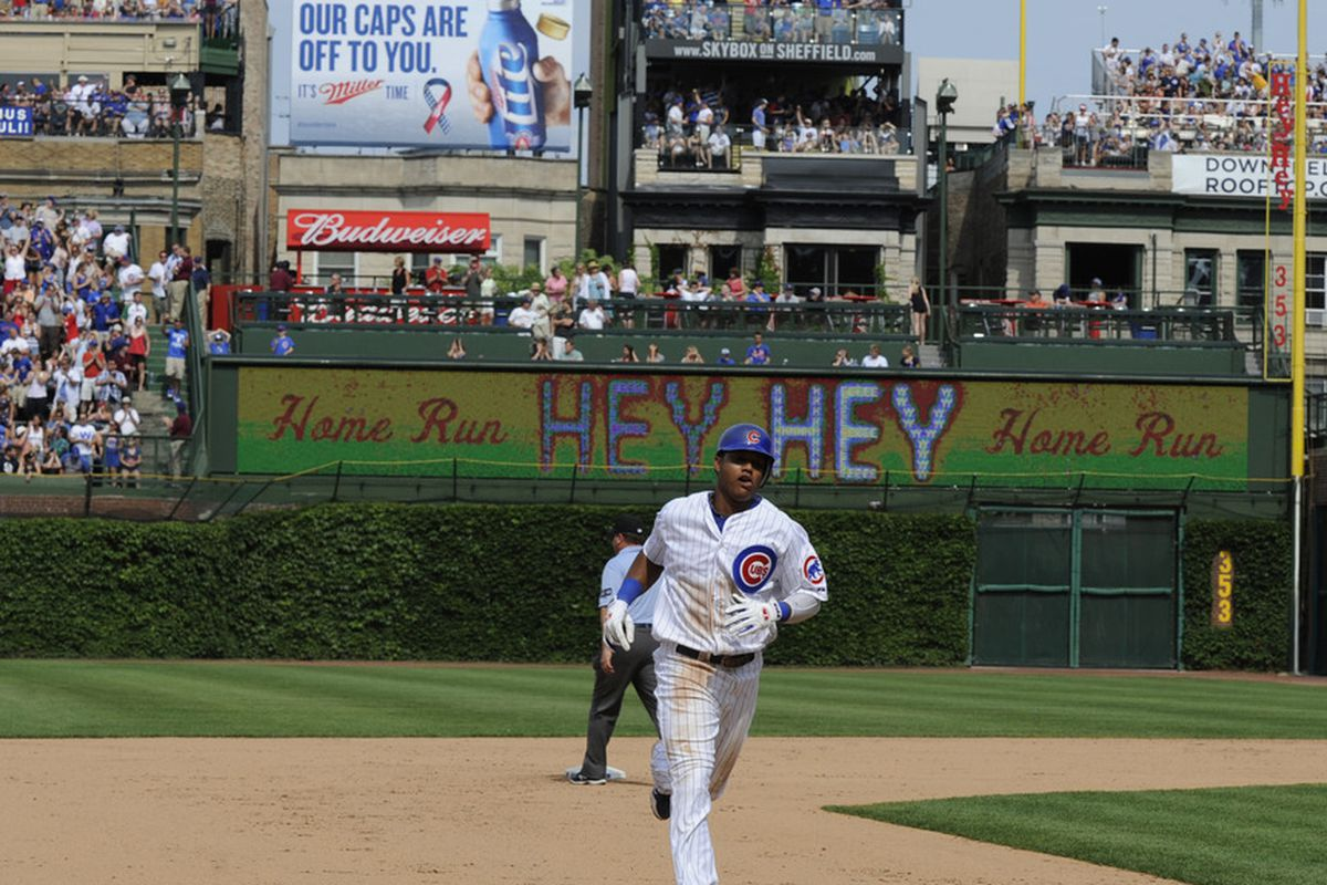 Starlin Castro of the Chicago Cubs hits a two-run homer against the San Diego Padres at Wrigley Field in Chicago, Illinois.  (Photo by David Banks/Getty Images)