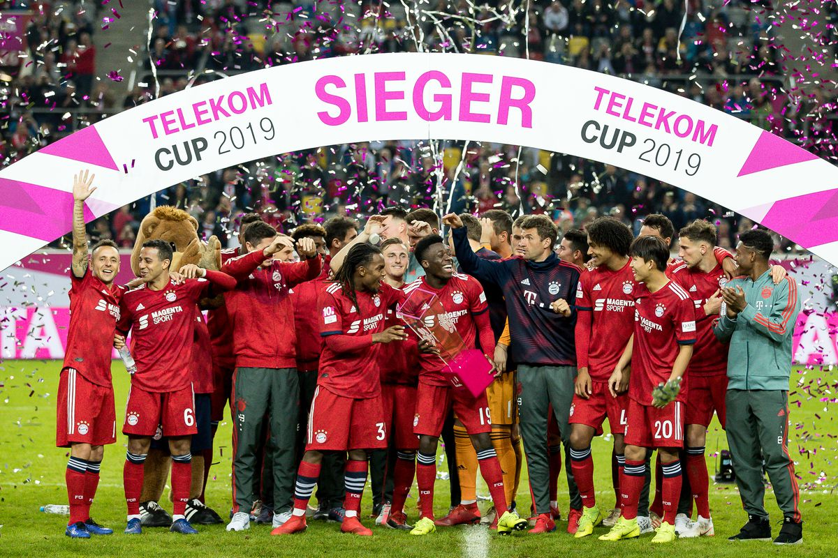 DUESSELDORF, GERMANY - JANUARY 13: Alphonso Davies of Bayern Muenchen celebrates with the trophy after winning the Telekom Cup 2019 Final between FC Bayern Muenchen and Borussia Moenchengladbach at Merkur Spiel-Arena on January 13, 2019 in Duesseldorf, Germany.