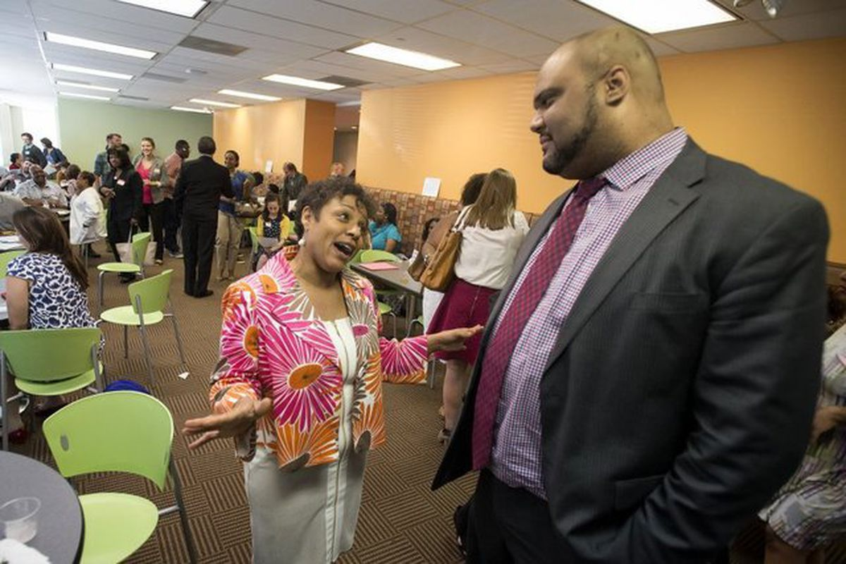 Tim Ware, who leads the state-run Achievement Schools in Memphis, talks with Whitney Achievement Elementary School Principal Debra Broughton during a 2015 meeting.