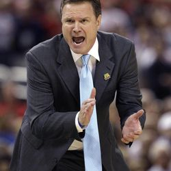 Kansas head coach Bill Self calls out to his team during the second half of an NCAA Final Four semifinal college basketball tournament game against Ohio State Saturday, March 31, 2012, in New Orleans.