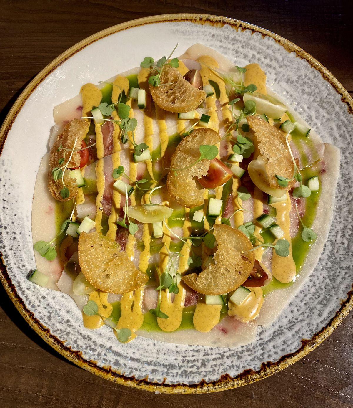A fish dish at Immigrant Food +