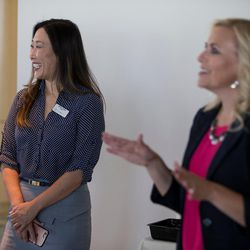 Sara Jones, left, and Cydni Tetro, right, greet participants at the Women Tech Awards finalist judging session in Salt Lake City on Thursday, July 28, 2016.