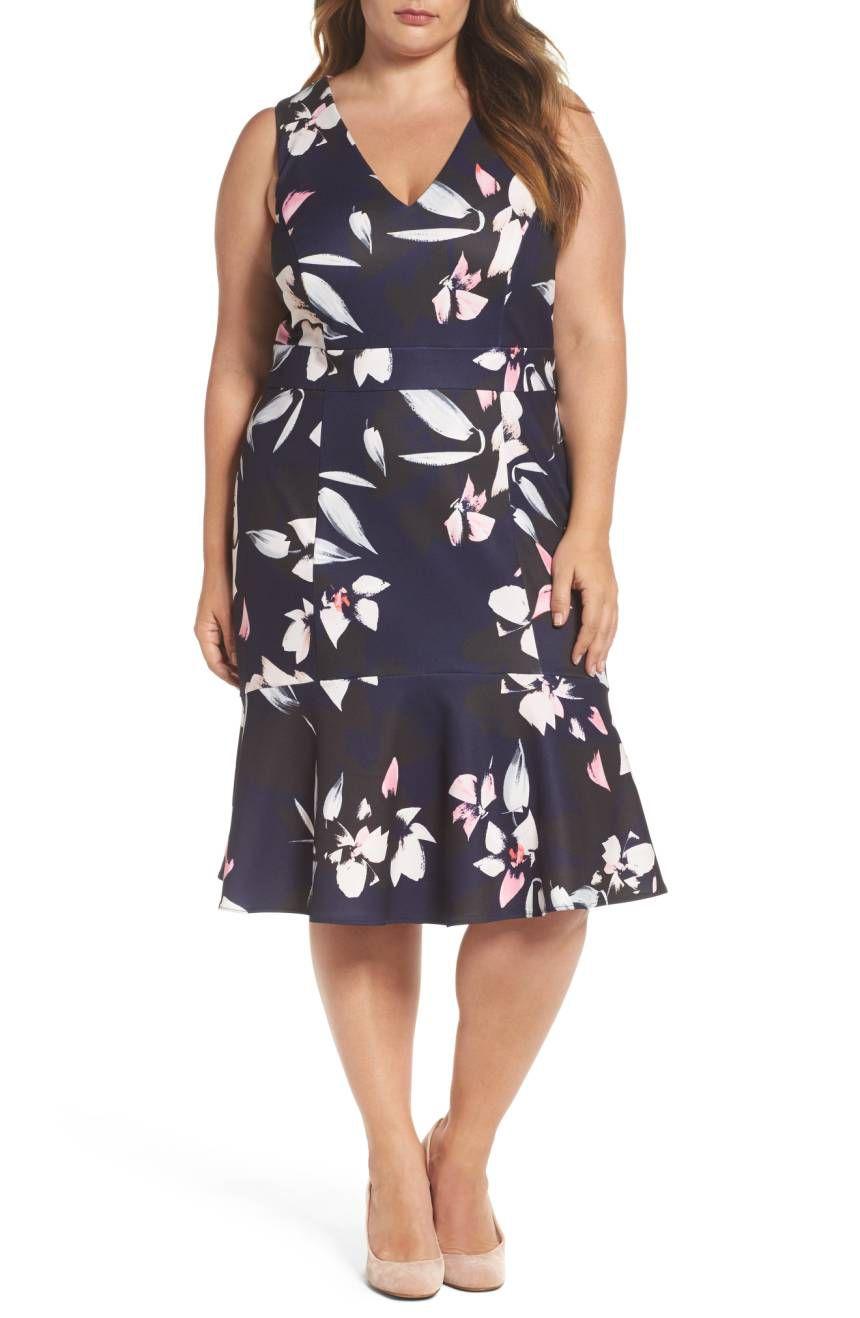 A navy floral sheath dress