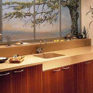 <p>In conjunction with counters of the same material, solid-surface backsplashes have an appealing seamless appearance. They also lend themselves to more decorative treatments, with inlays and sandblasted details.</p>