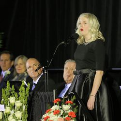 """Granddaughter Jayne Edwards sings """"Amazing Grace"""" at a memorial for  former BYU football coach LaVell Edwards  at the Provo Convention Center on Friday, Jan. 6, 2017."""