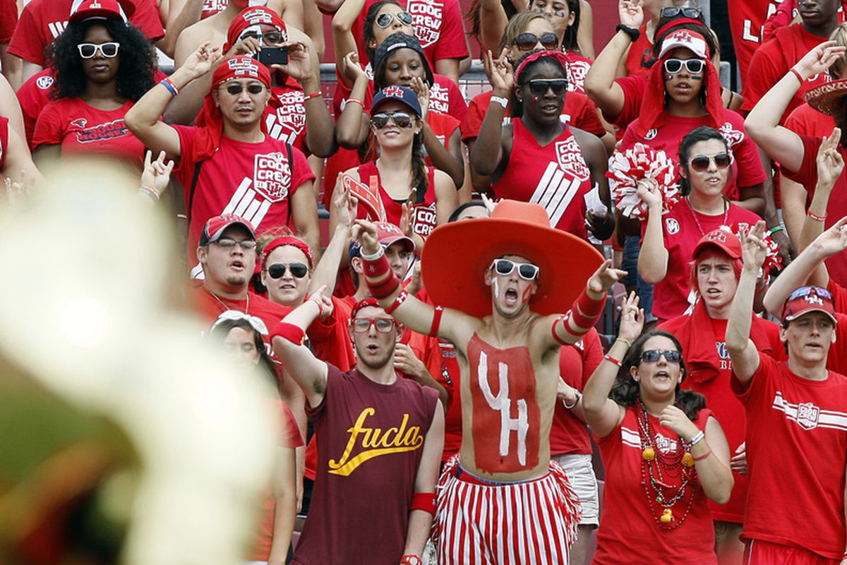 HOUSTON - SEPTEMBER 03:  Houston Cugar students and fans cheer on their team as they make their way onto the field to play UCLA at Robertson Stadium on September 3, 2011 in Houston, Texas.  (Photo by Bob Levey/Getty Images)